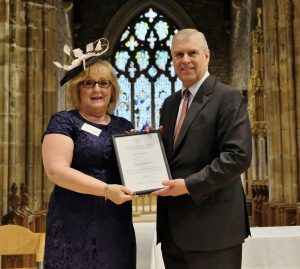Jackie receiving the award from HRH The Duke of York